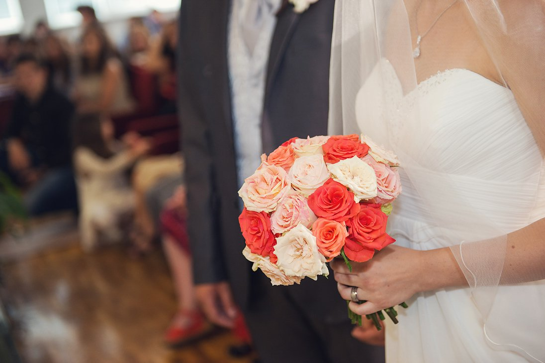 Bride is holding the wedding bouquet