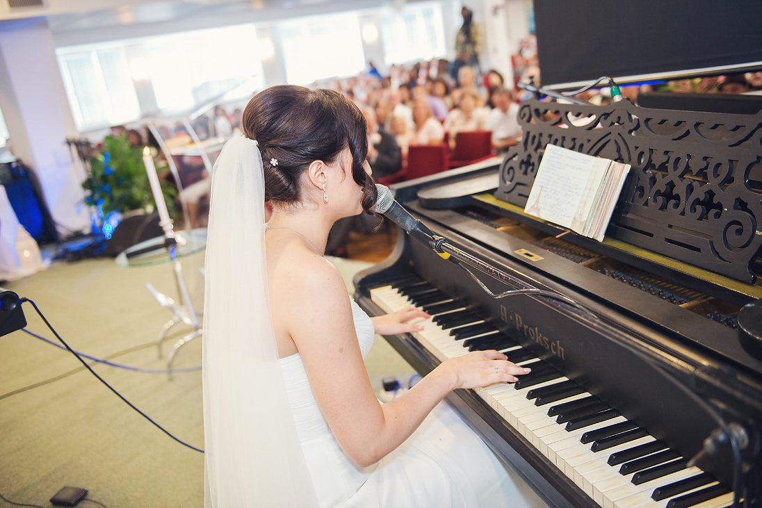 Bride is playing the piano