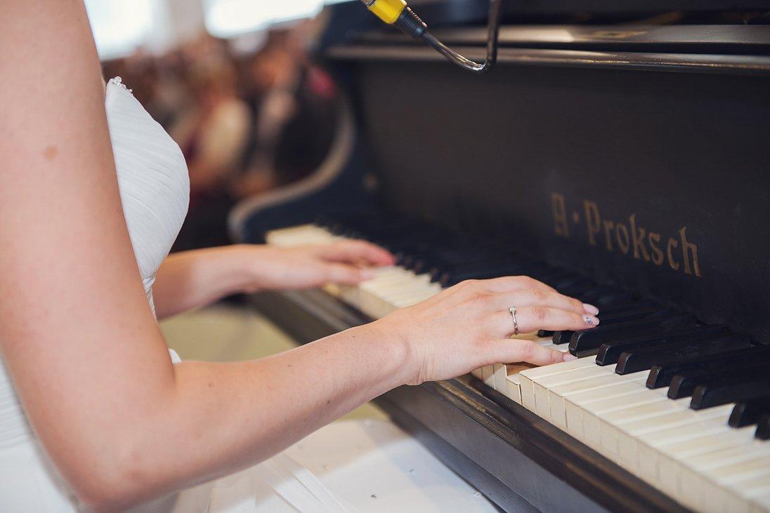 Kalina the bride playing the piano at church
