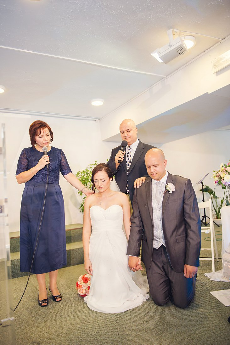 Mother and father are blessing the newlyweds