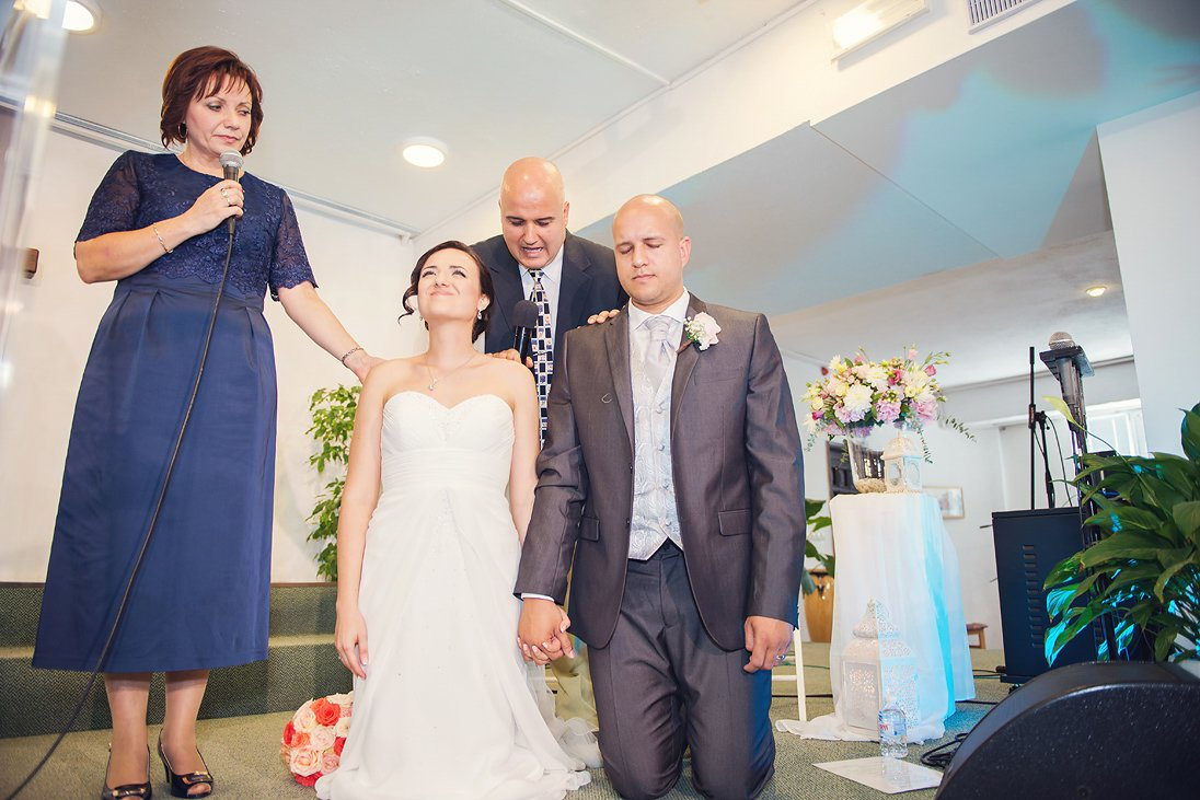 Mother and father are blessing the newlyweds at church in Burgas