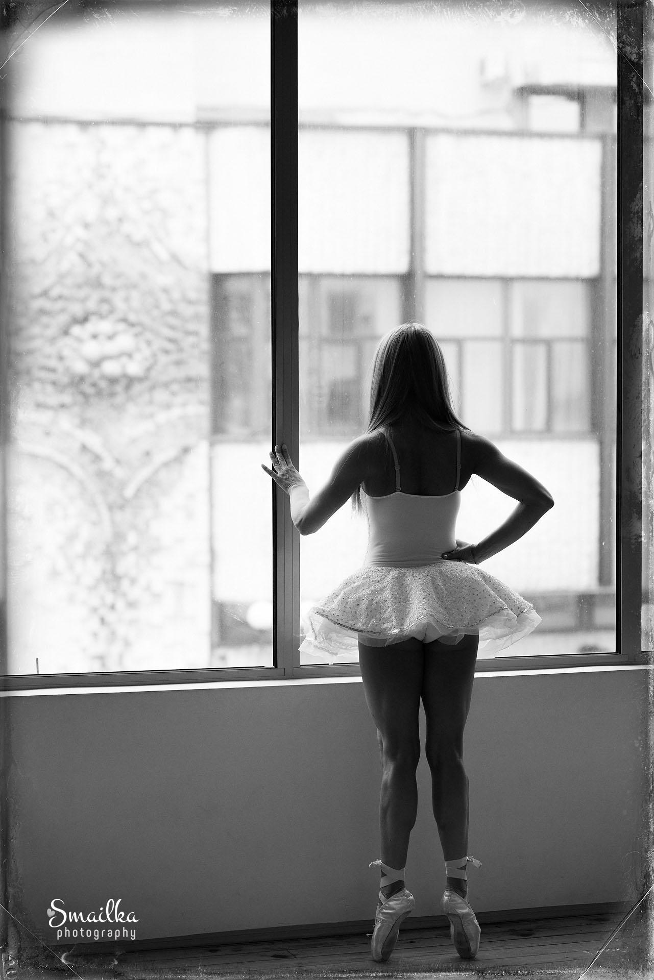 Ballerina photo standing by the window Dobrich Yanica