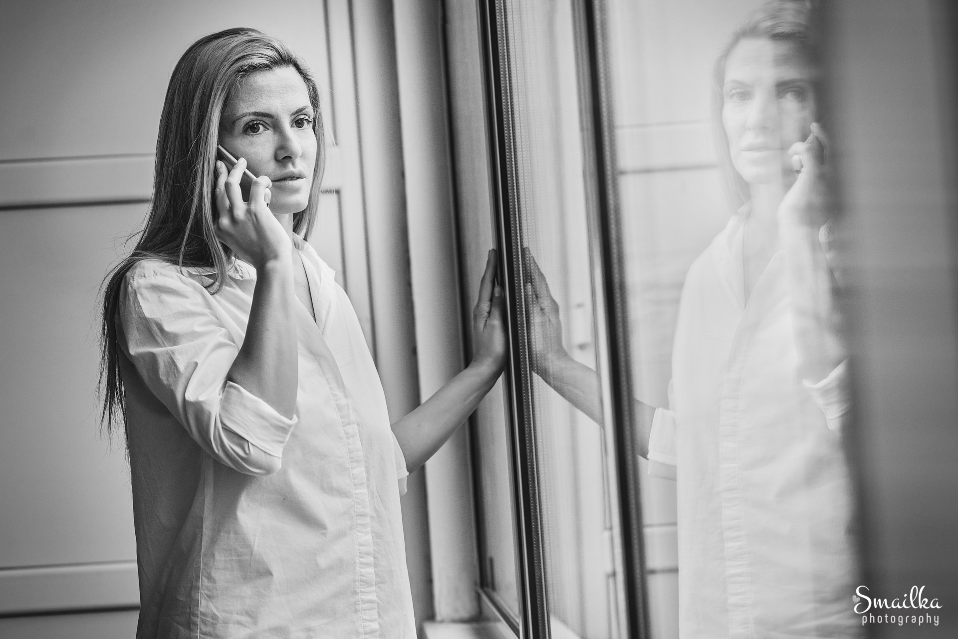 Lifestyle photography Portrait of a woman by a window