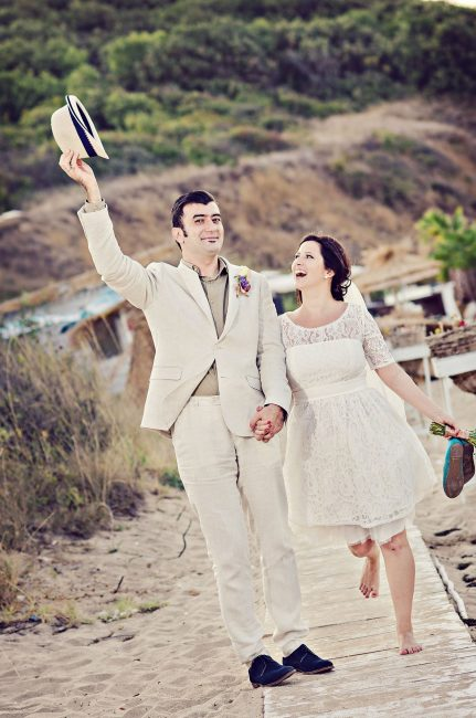Wedding couple beach photosession of joy and happiness