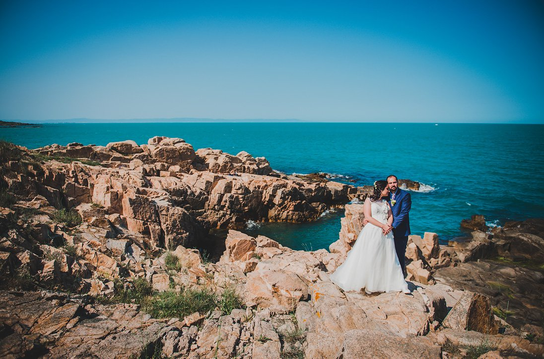 Wedding photosession Photo of bride and groom in scenic environment of sea and rocks