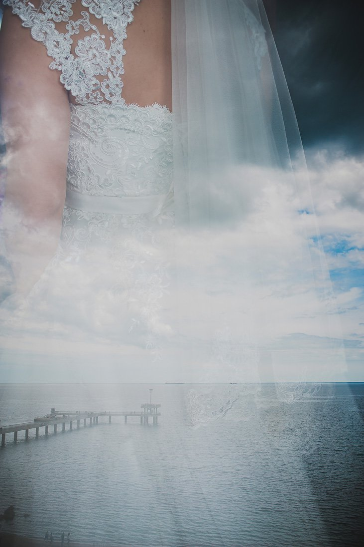 Wedding dresss on the sea background, double exposure