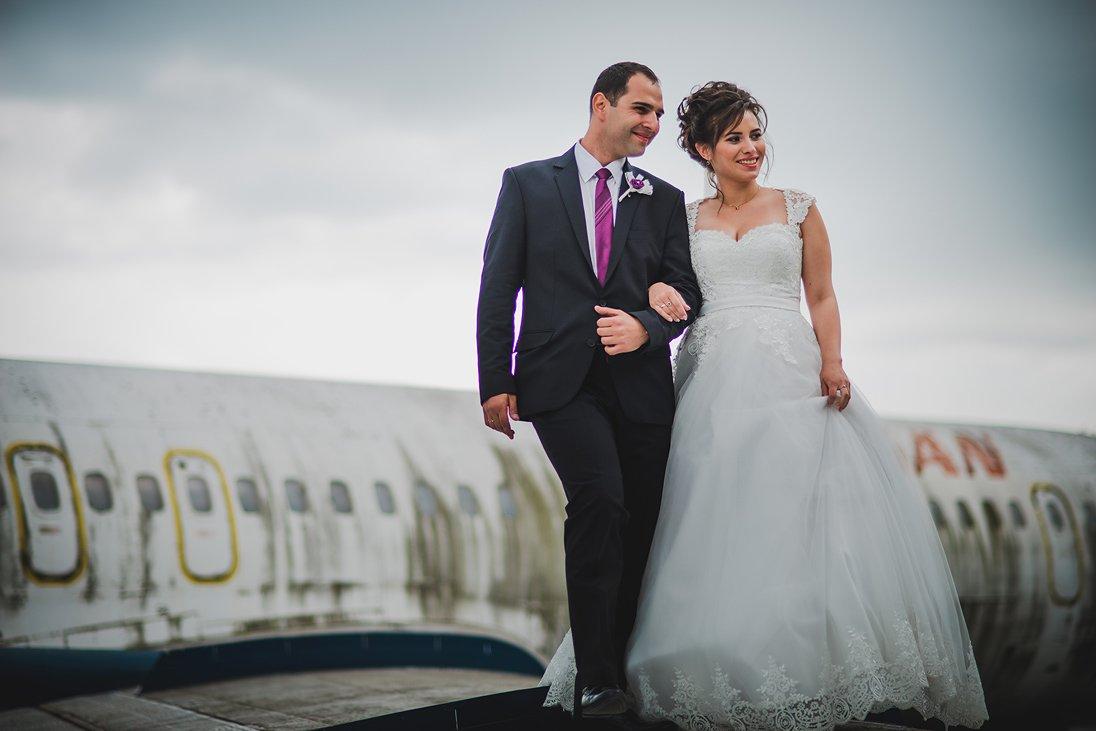 Happy wedding couple on an airplane