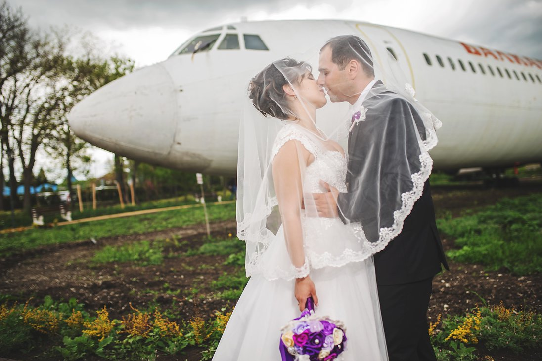 Wedding couple kissing under the veil