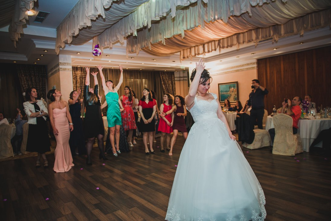 Bride tossing the bridal bouquet