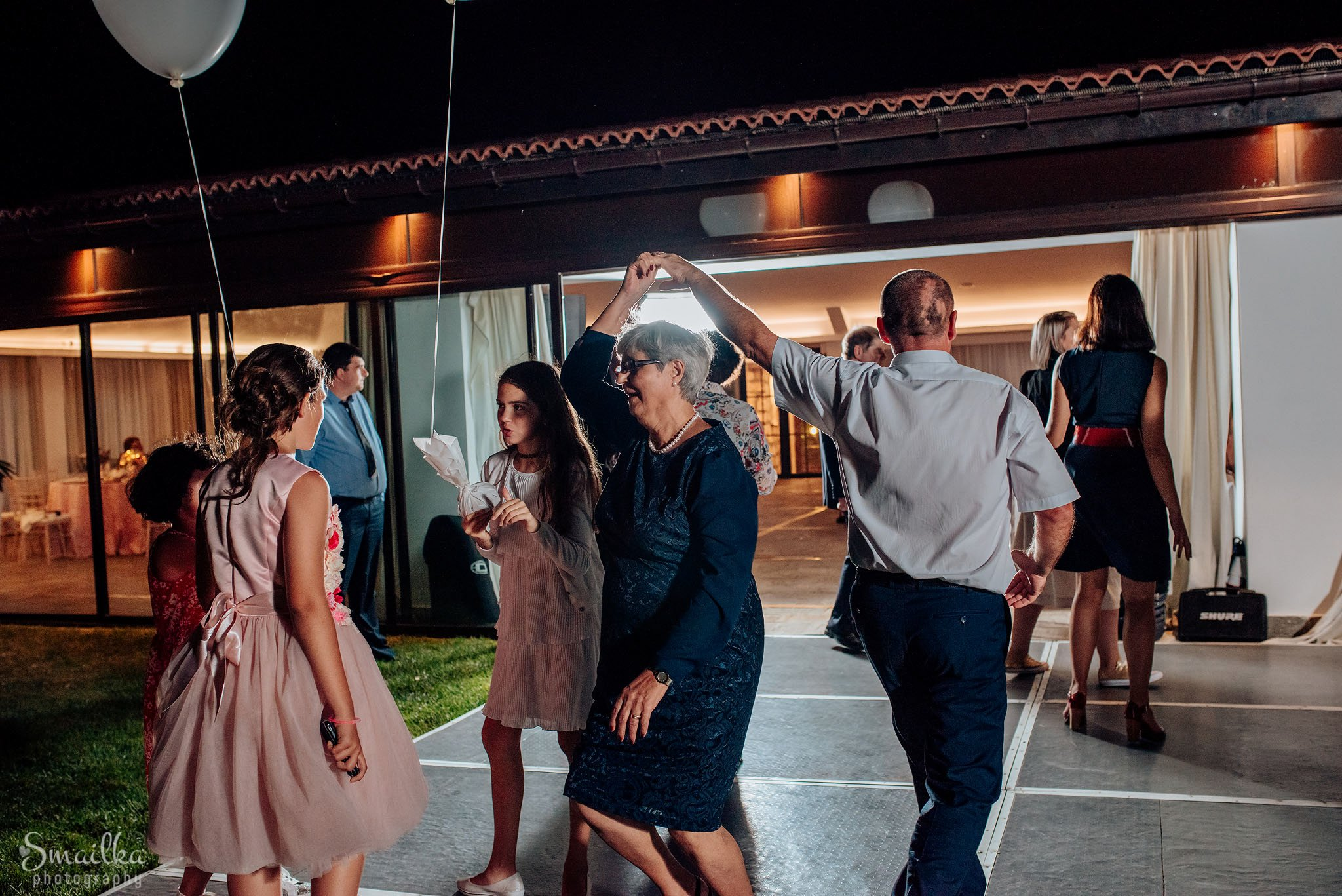 Guests on wedding dancing outside the restaurant at Black Sea Rama