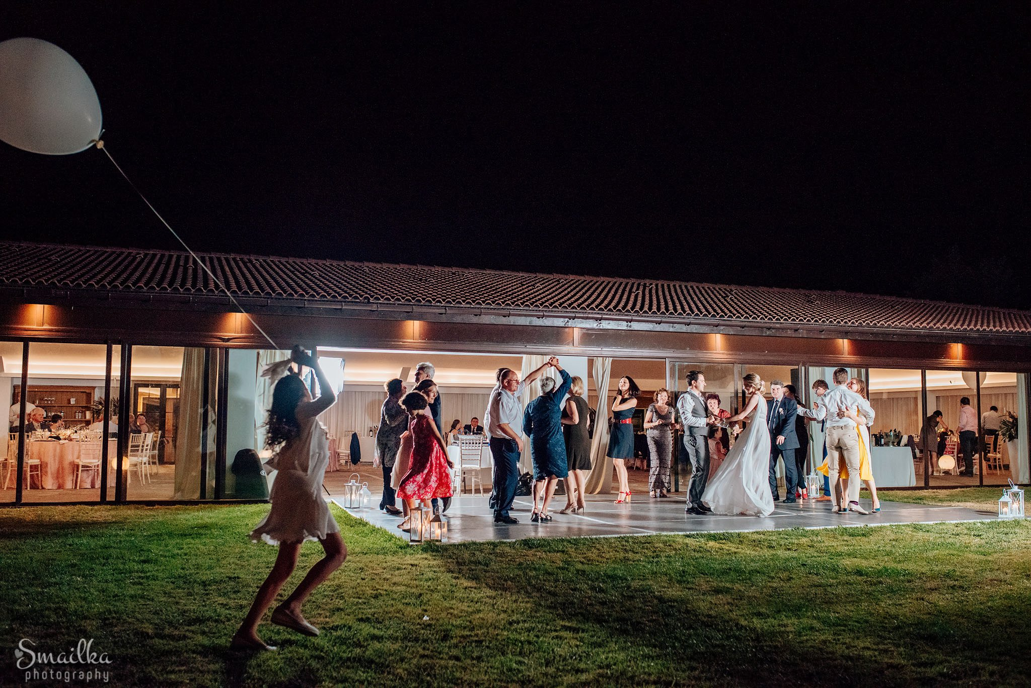 Wedding couple and guests dancing at night at Black Sea Rama