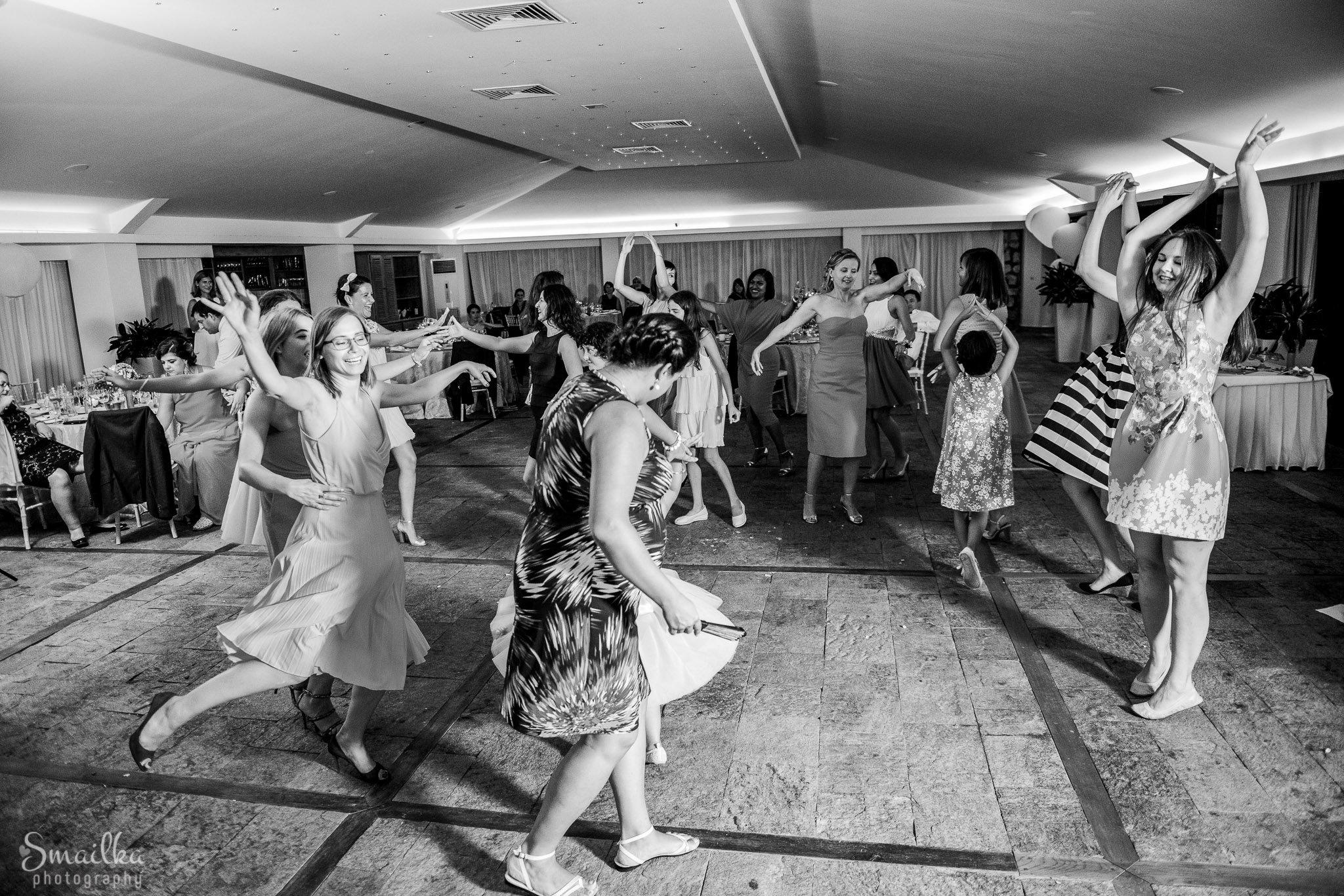 Girl dancing wildly at wedding of Ana and Boz