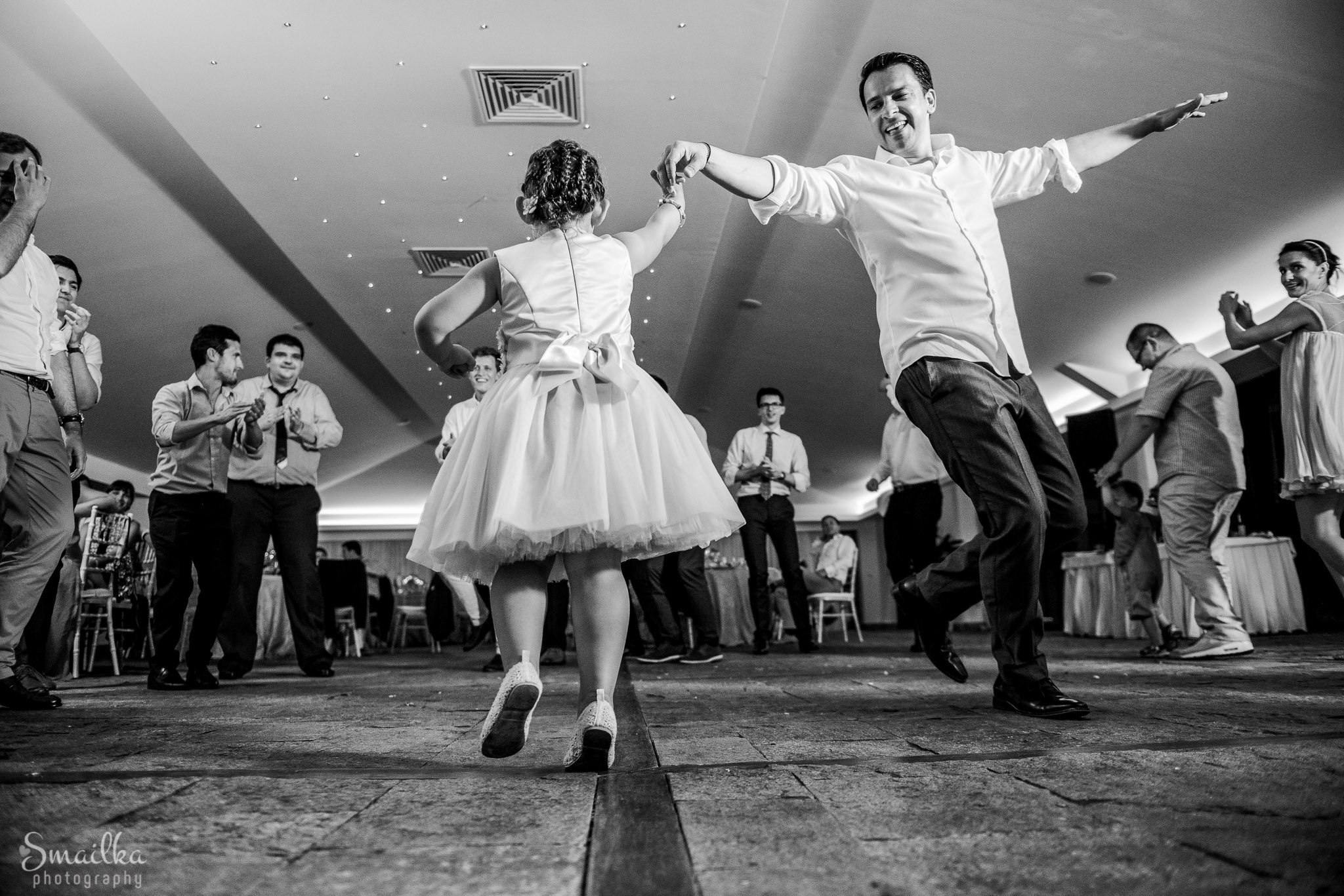 Groom dancing with a little bride