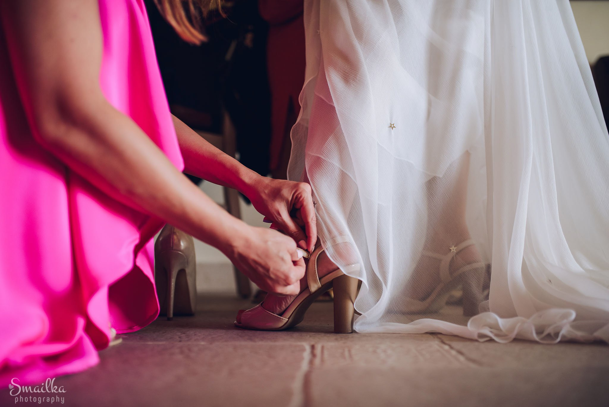 Bride putting her wedding shoes on at Black Sea Rama