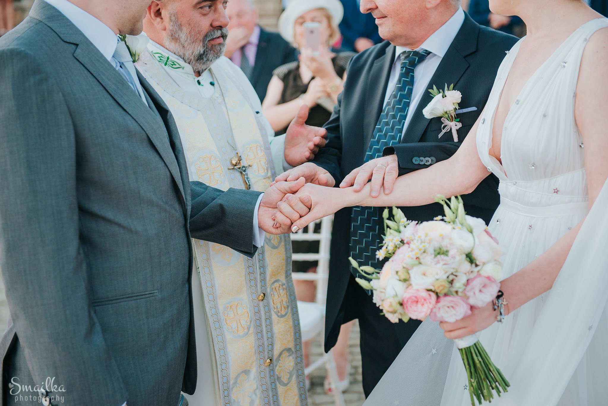 Bride and groom holding hands on a wedding ceremony
