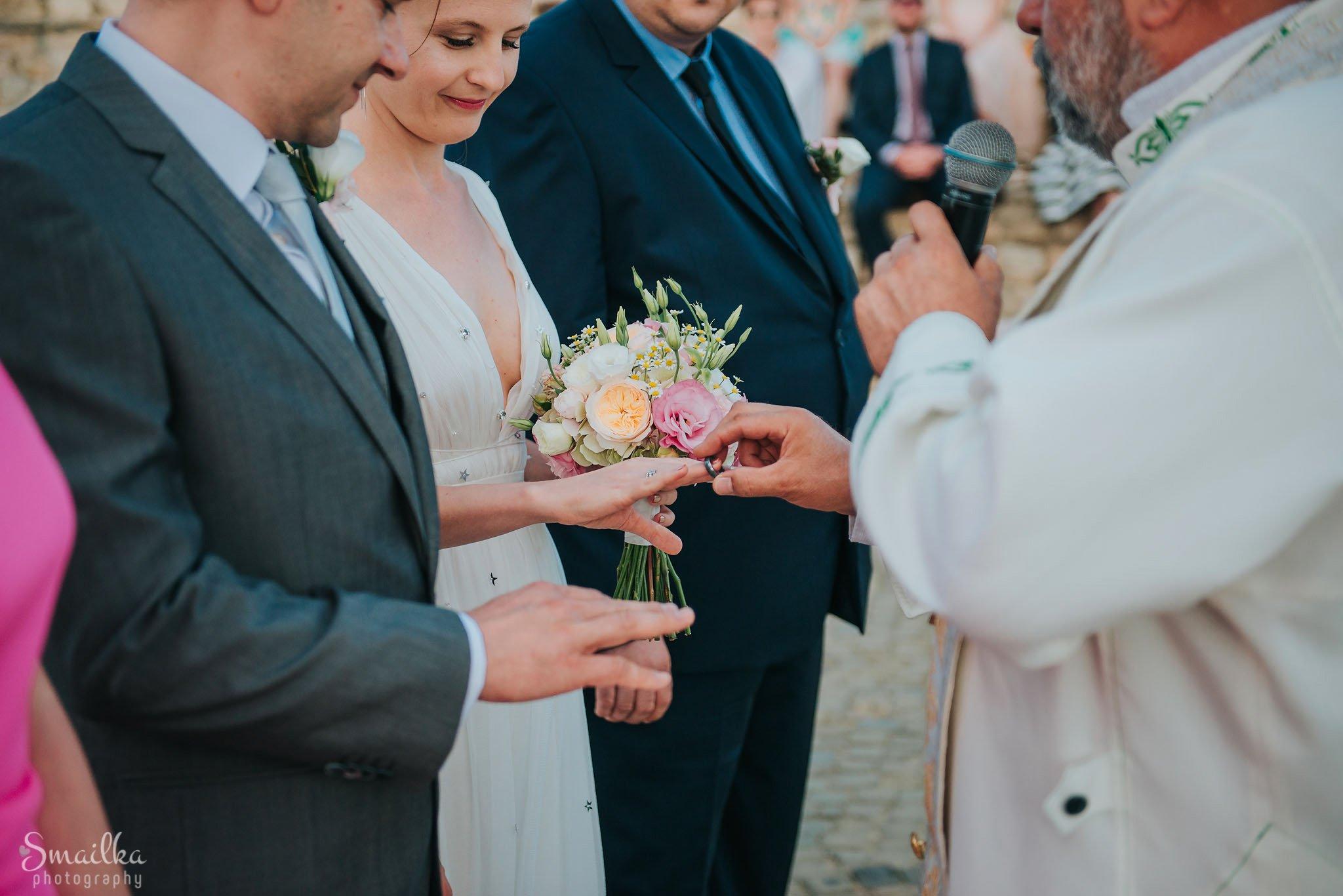Putting the wedding rings at Black Sea Rama