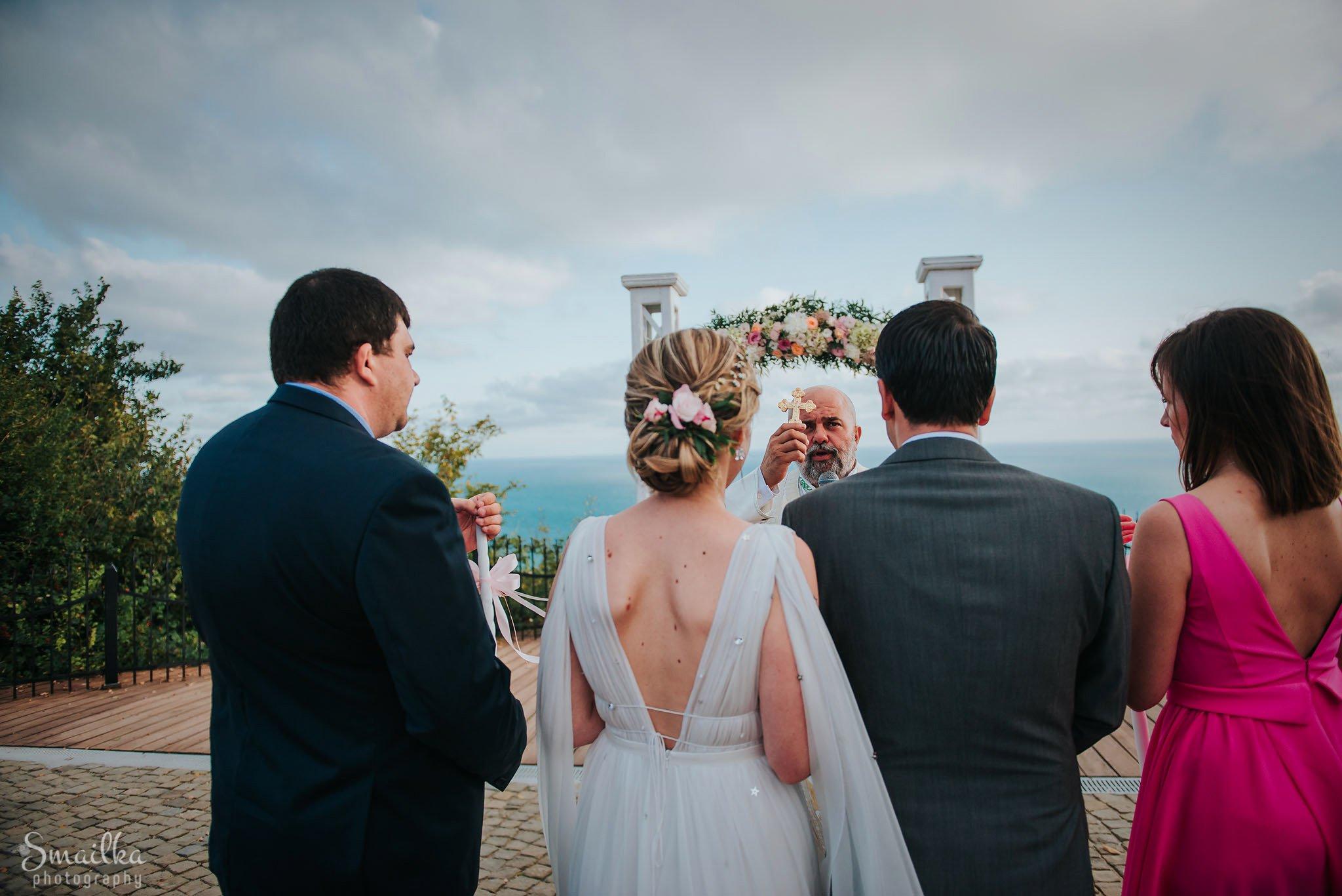 Bride, groom, wedding priest, best man and maid-of-honor