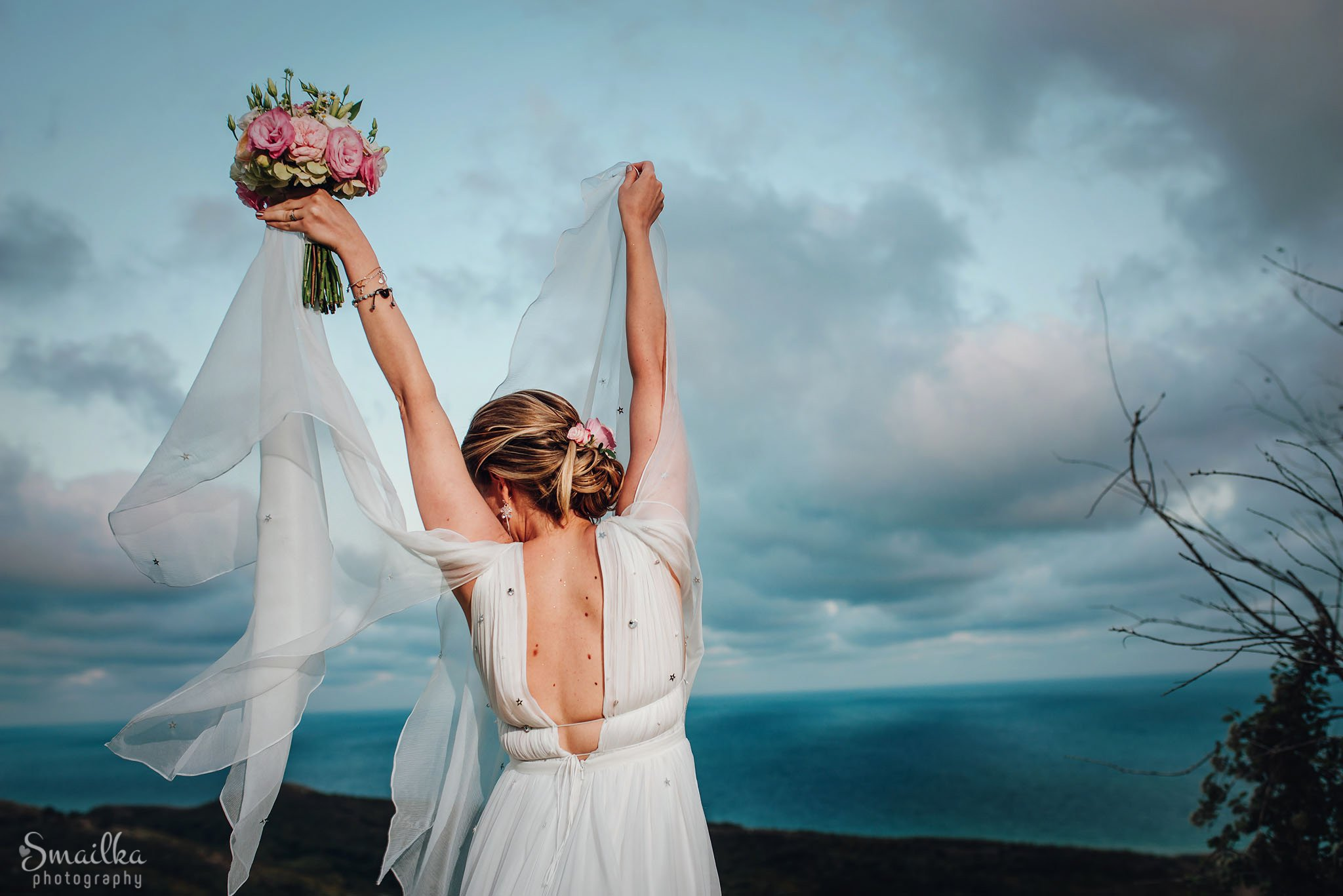 Bride is happy by the sea