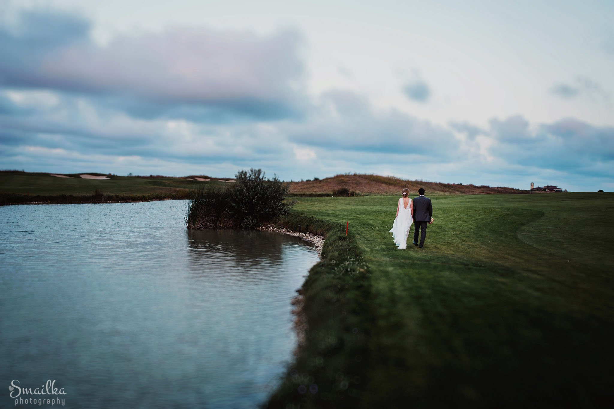 Bride and groom walking the green fields of Black Sea Rama