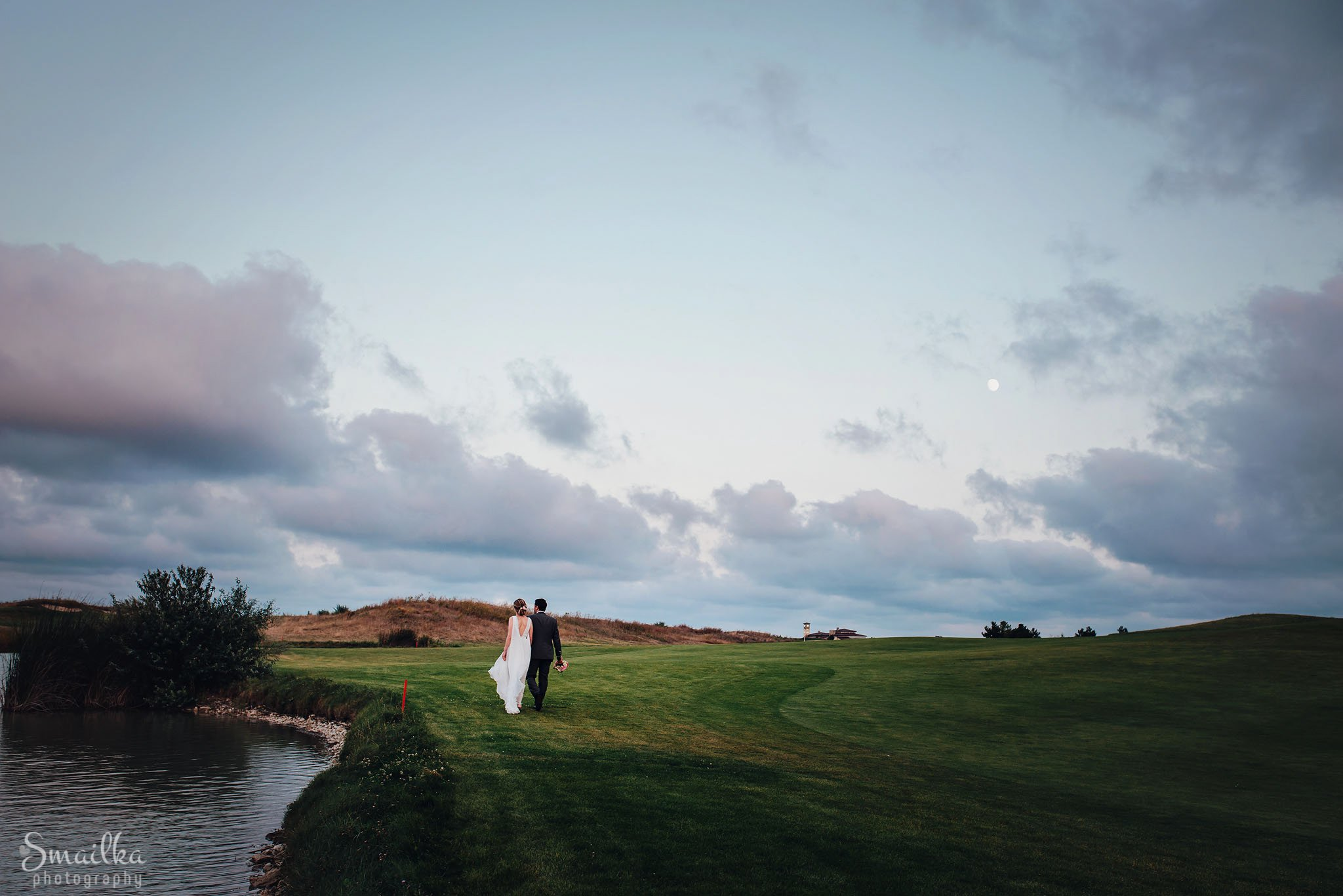 Lake, bride, groom, green golf fields and a moon at Black Sea Rama