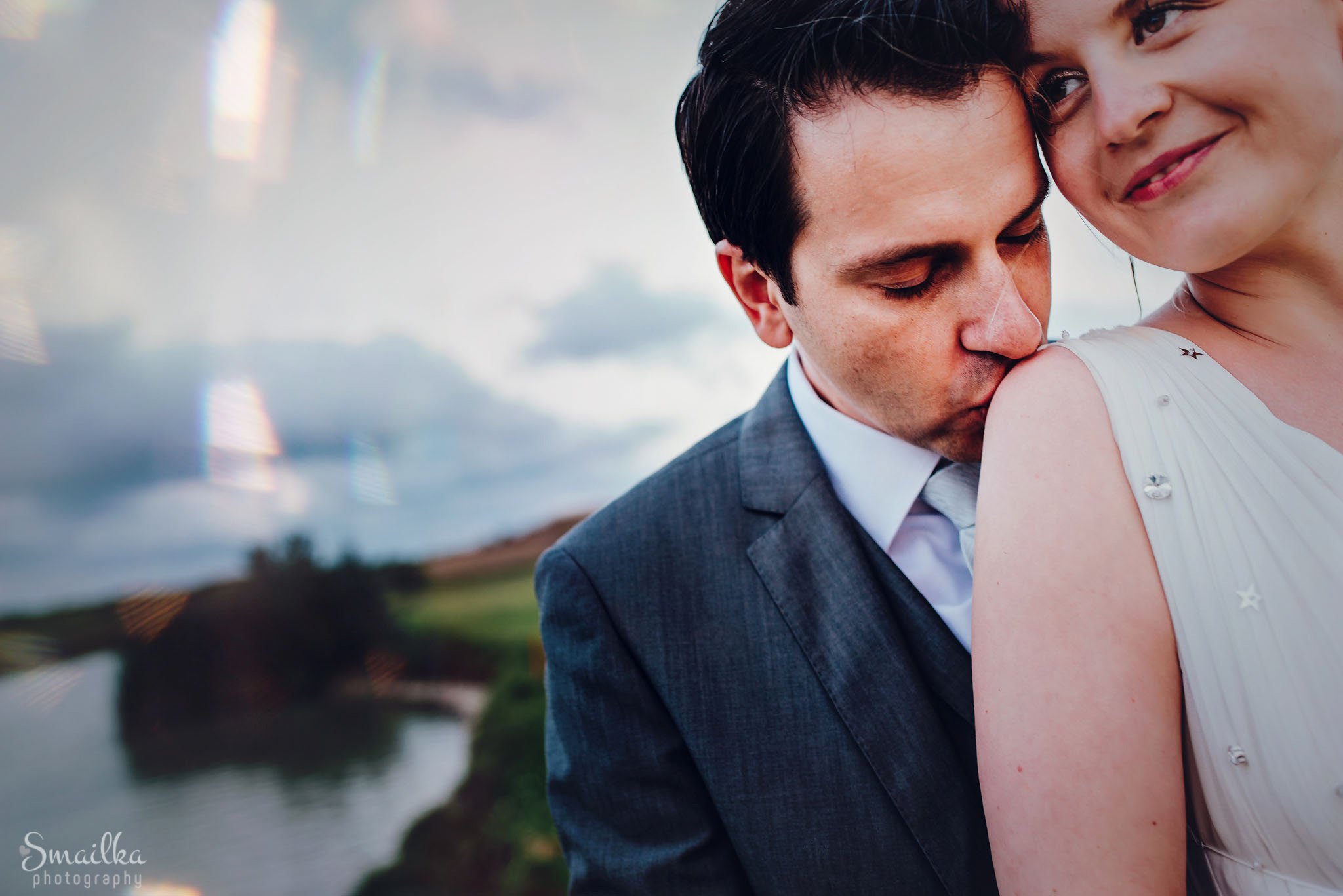Groom kissing the bride on wedding photo session