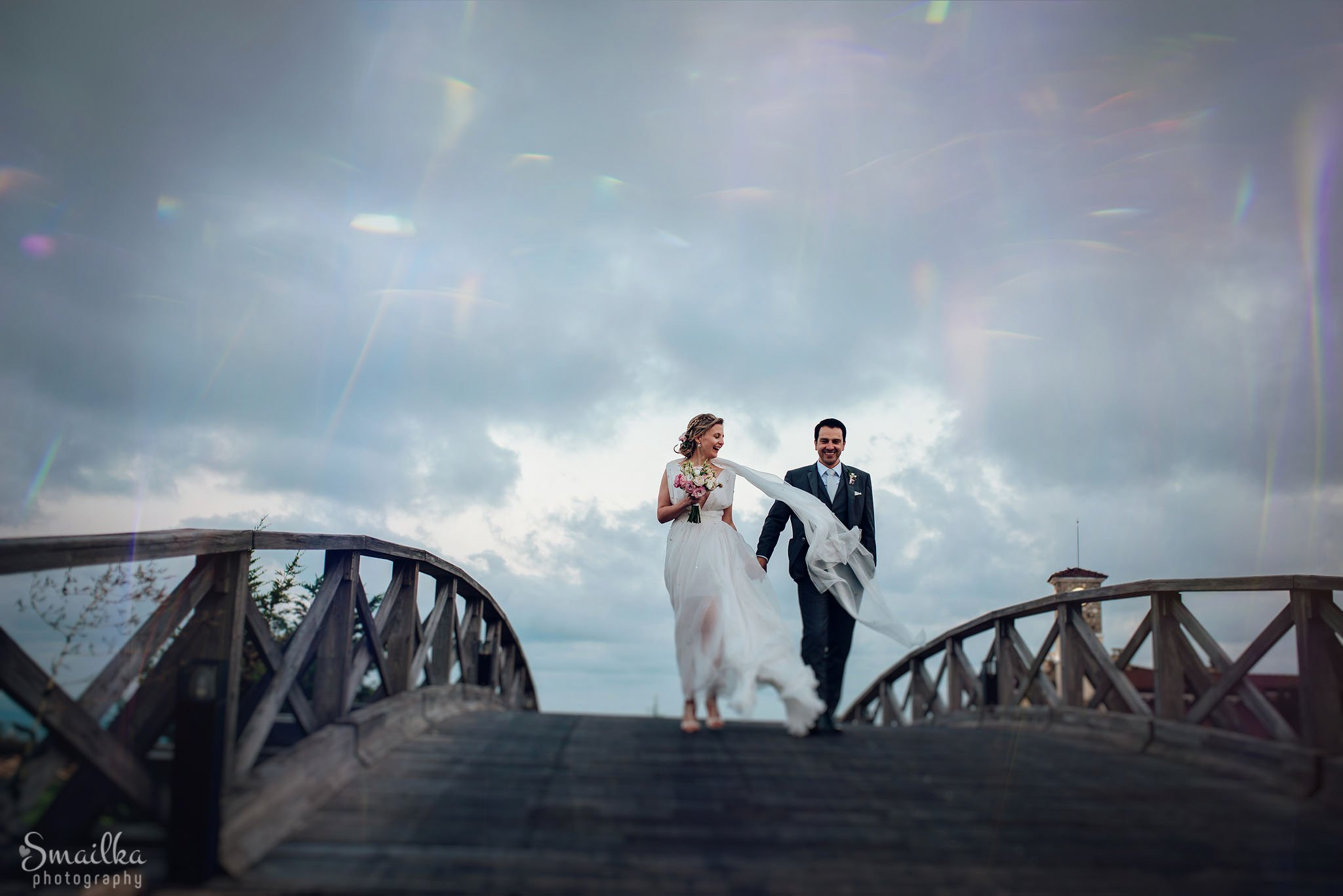 Bride and groom walking on a bridge at Black Sea Rama
