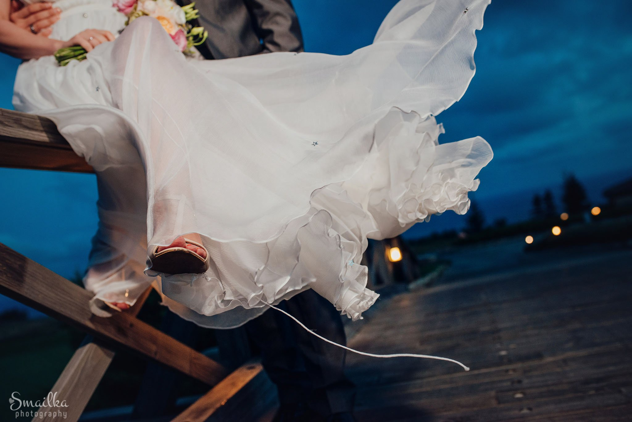 Splendid light wedding dress on a photo session