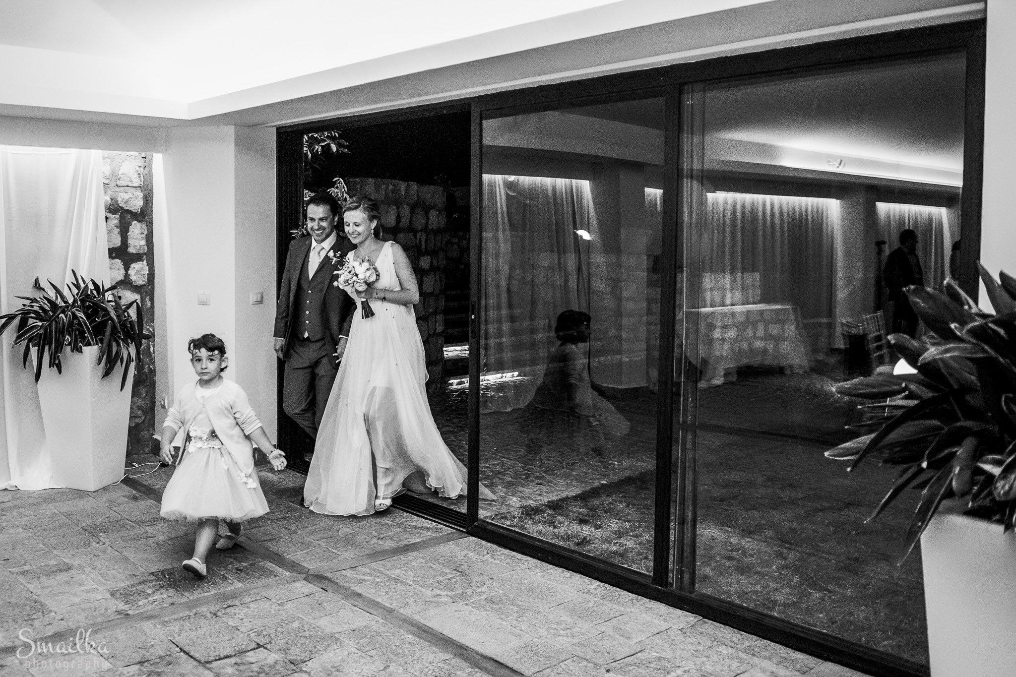 Ana and Boz entering the wedding restaurant