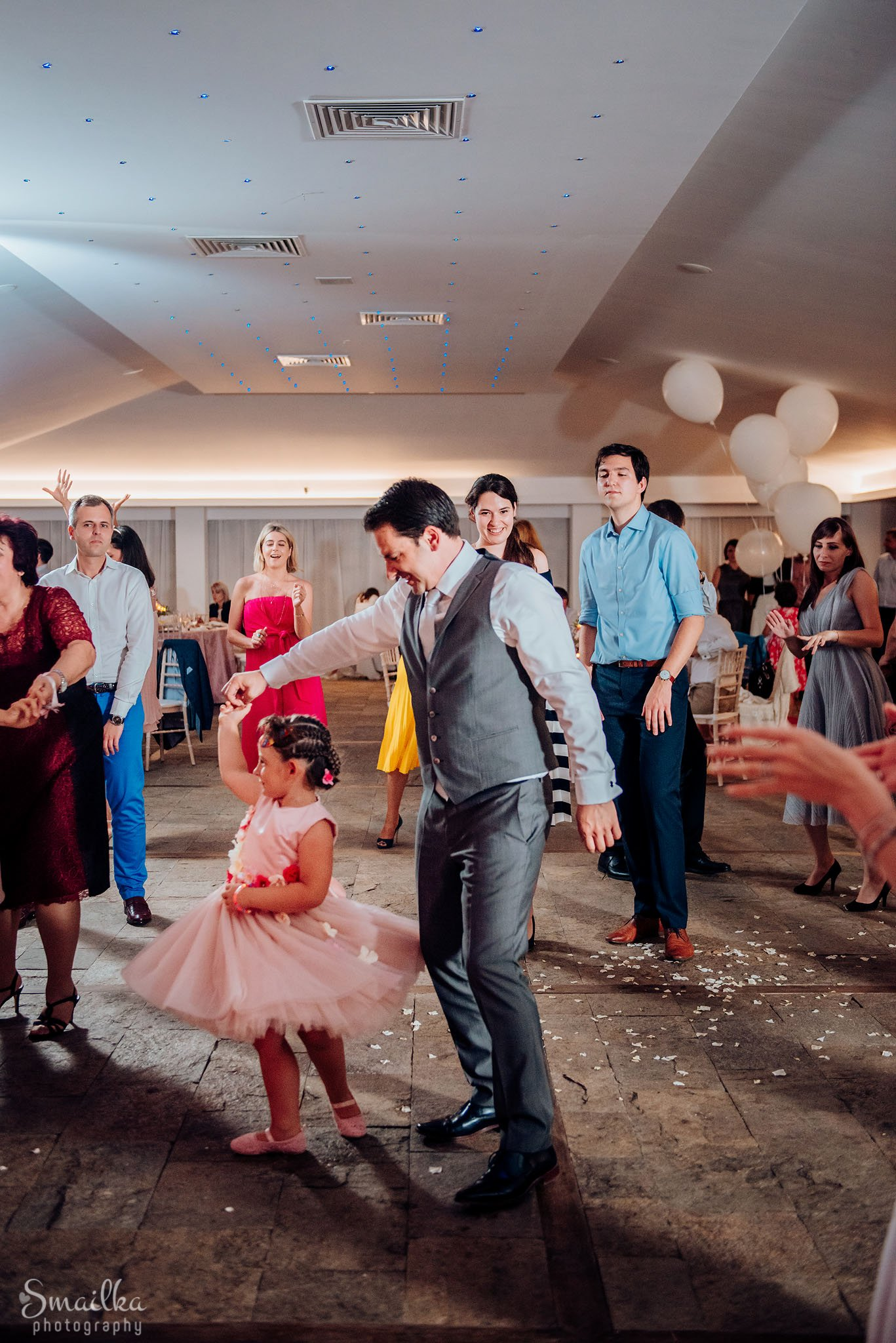 Groom dancing with a kid